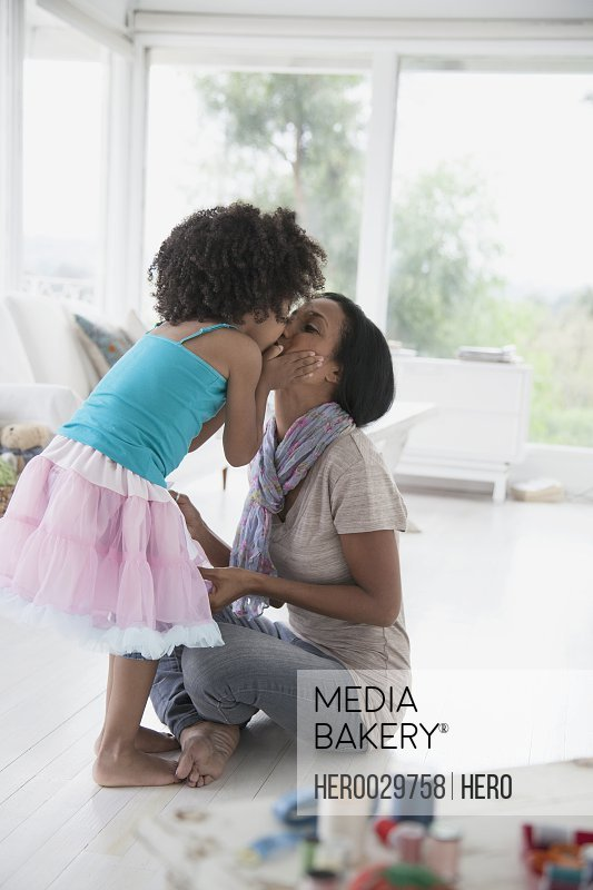 young daugher giving her mom a big kiss