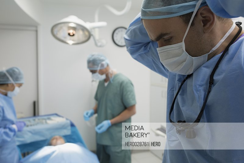 Plastic surgeons preparing in operating room