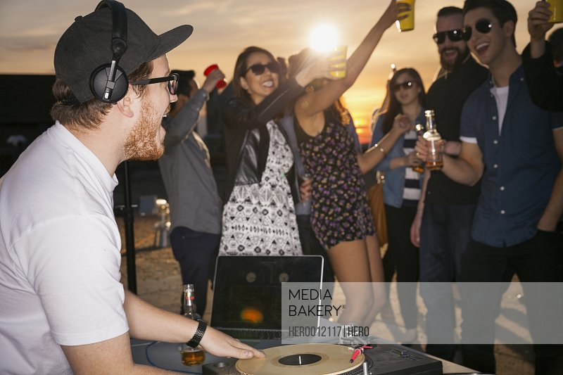 DJ playing music at rooftop party