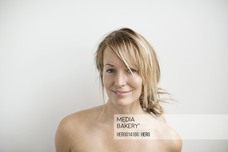 Portrait of blonde woman with bare chest