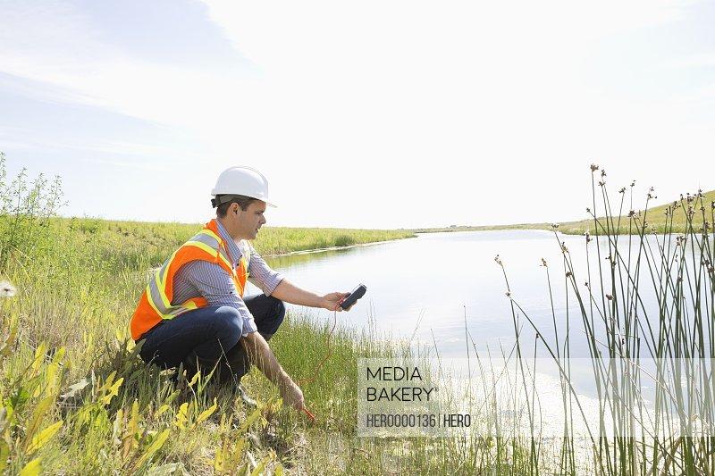 Ecologist testing near riverbank