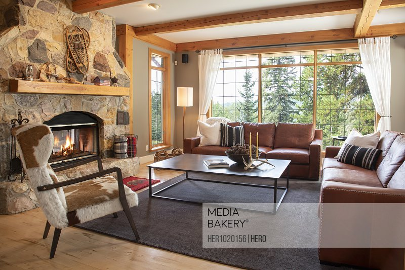Home showcase interior living room with leather sofas and stone fireplace