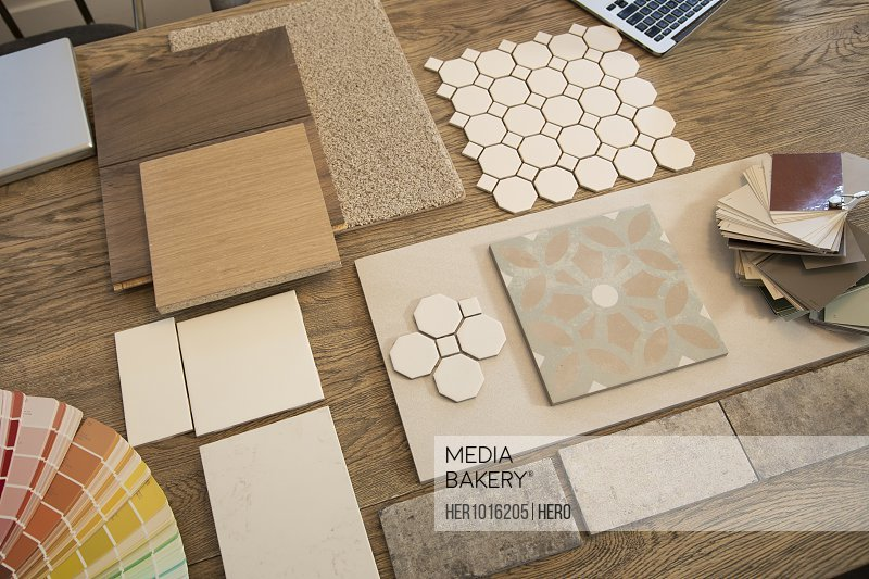 Interior design tile, wood floor, carpet and paint samples on table
