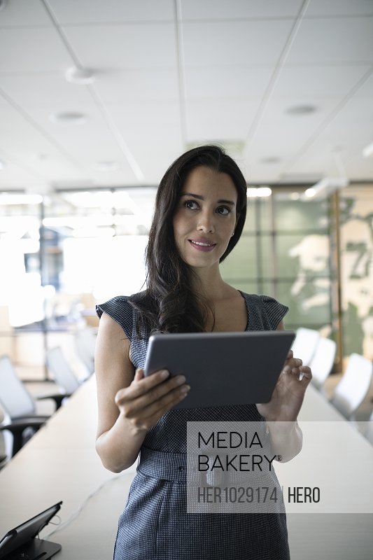 Portrait of businesswoman using digital tablet and smiling