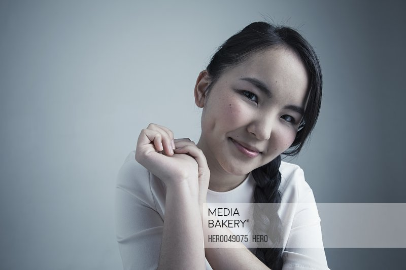 Portrait confident Asian young woman with black braided hair