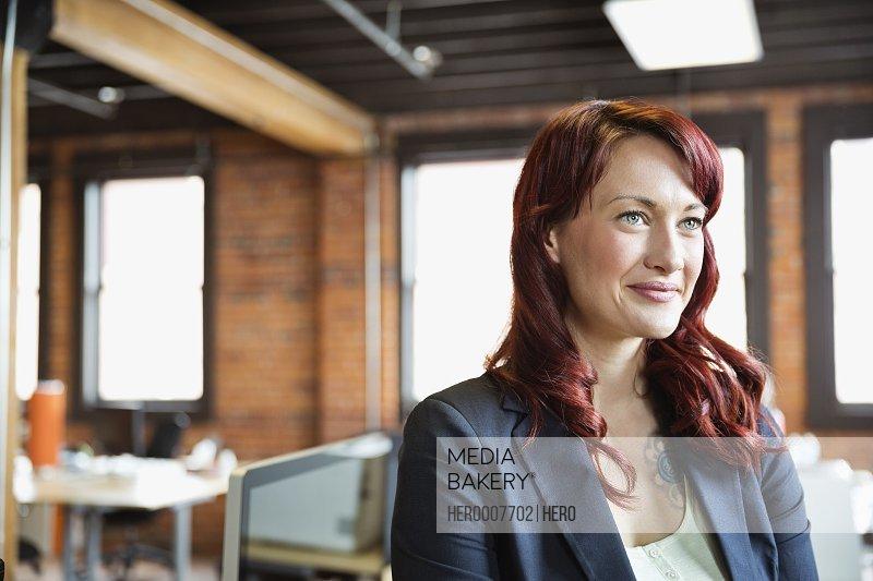 Female entrepreneur in creative office space