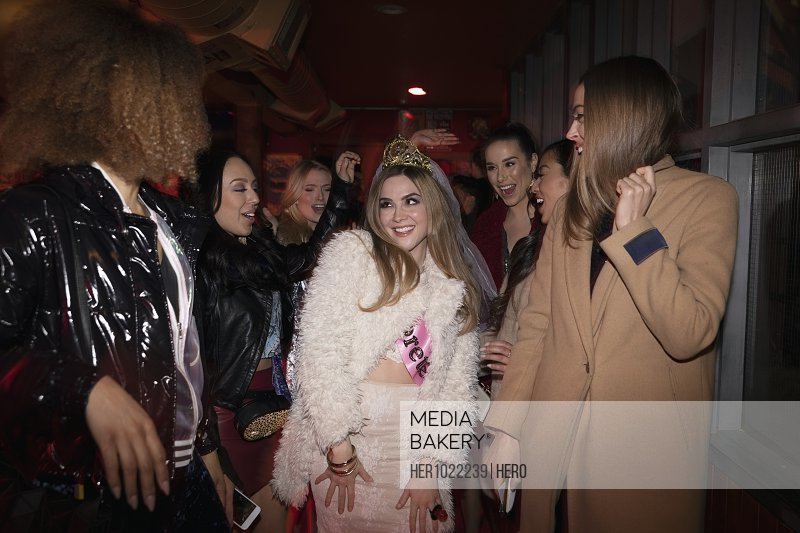 Bachelorette and friends waiting in nightclub queue