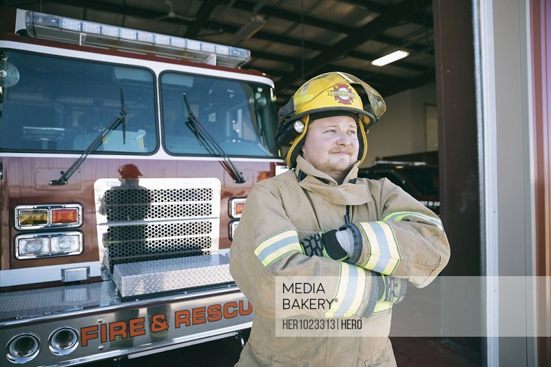 Portrait confident firefighter with arms crossed