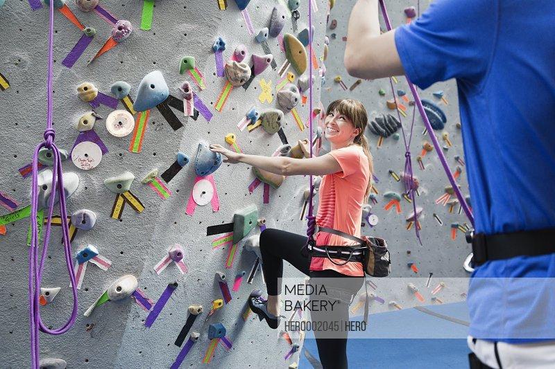 Female indoor rock climbing