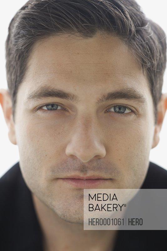 Close-up portrait of confident man
