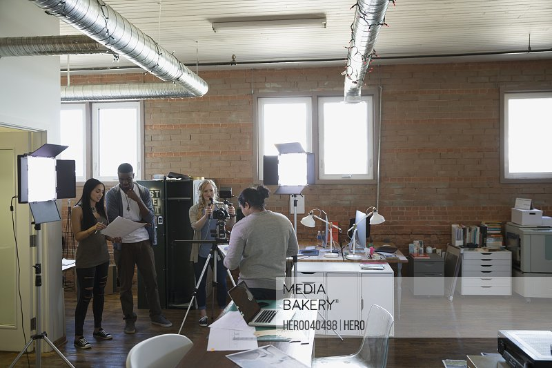 Creative business people filming tutorial