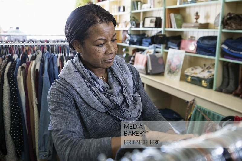 Woman shopping in vintage clothing shop