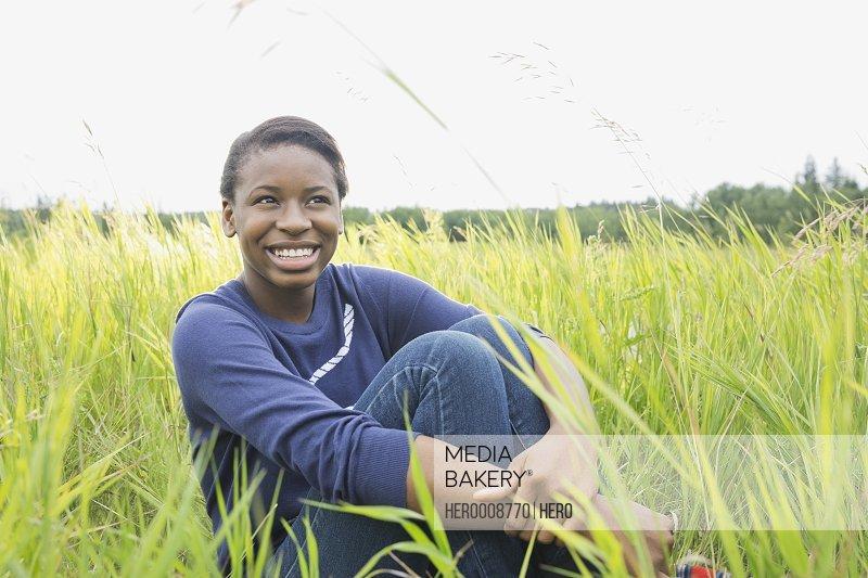 Portrait of girl sitting in field