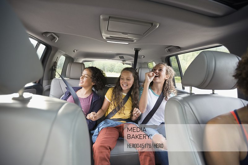 Sisters riding in back seat of SUV