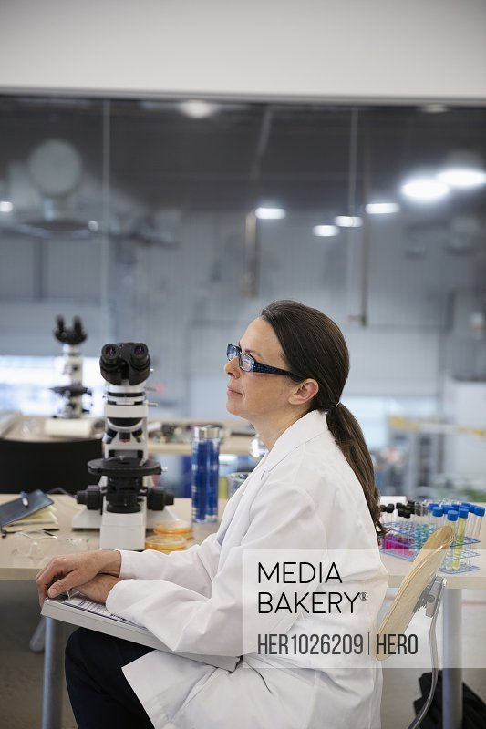 Thoughtful female scientist working in laboratory