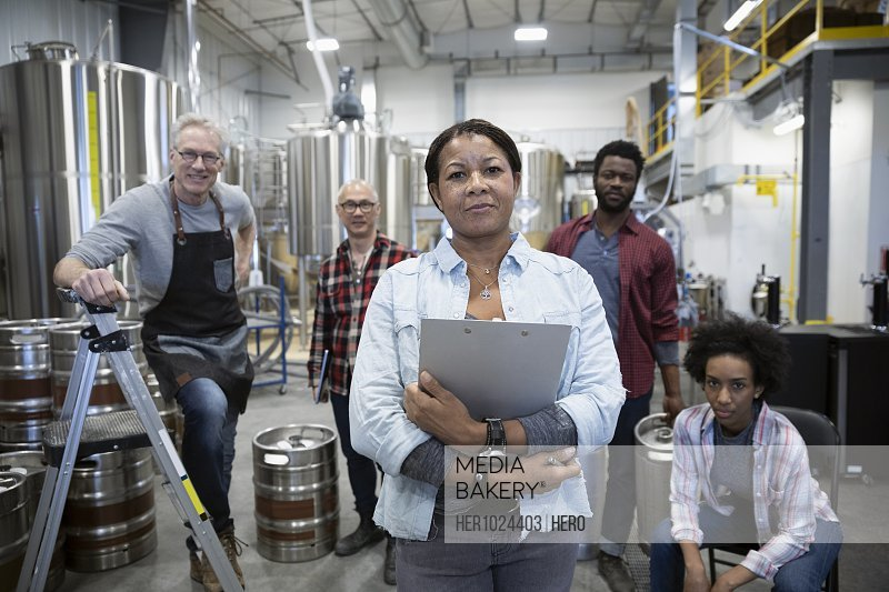 Portrait confident brewers in brewhouse distillery
