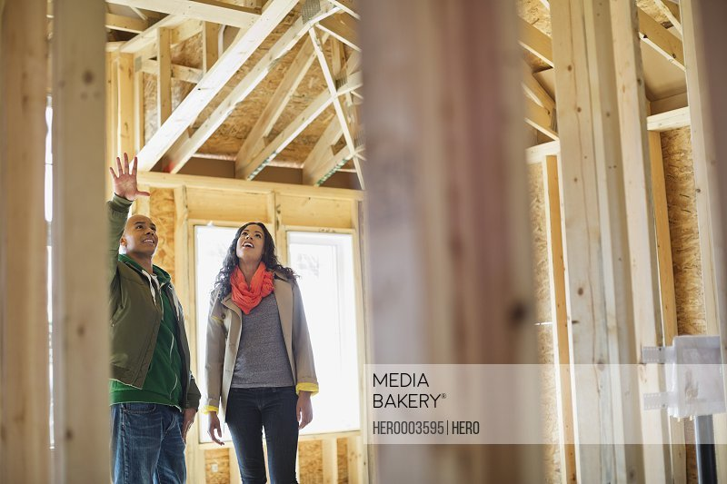 Young couple visiting new home construction site