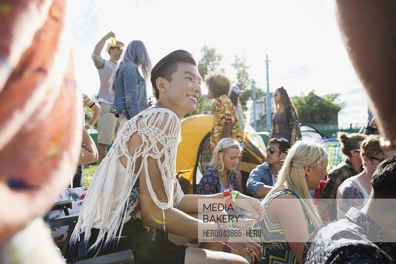 Smiling young man enjoying summer music festival