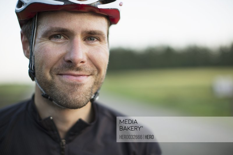 portrait of mid-adult male street bicyclist