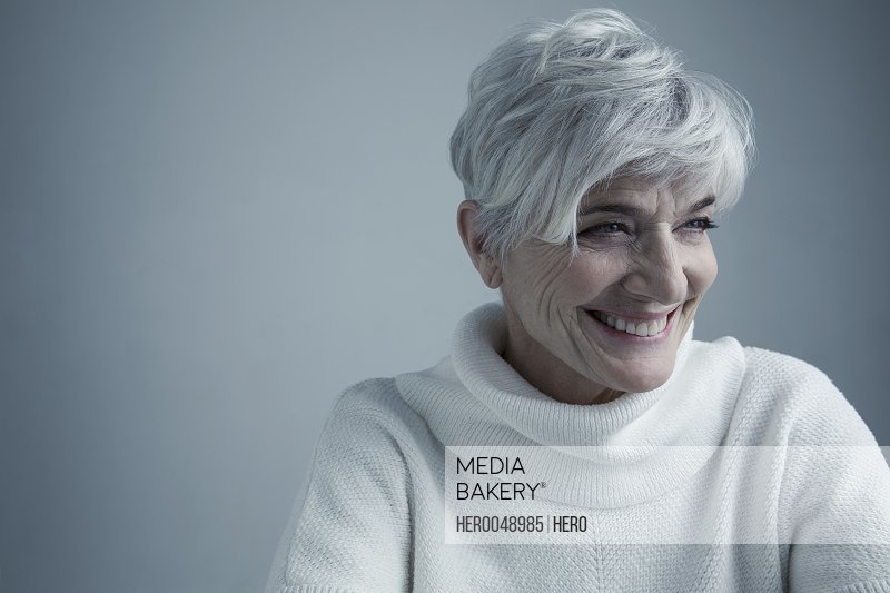 Portrait smiling Caucasian senior woman with short white hair looking away