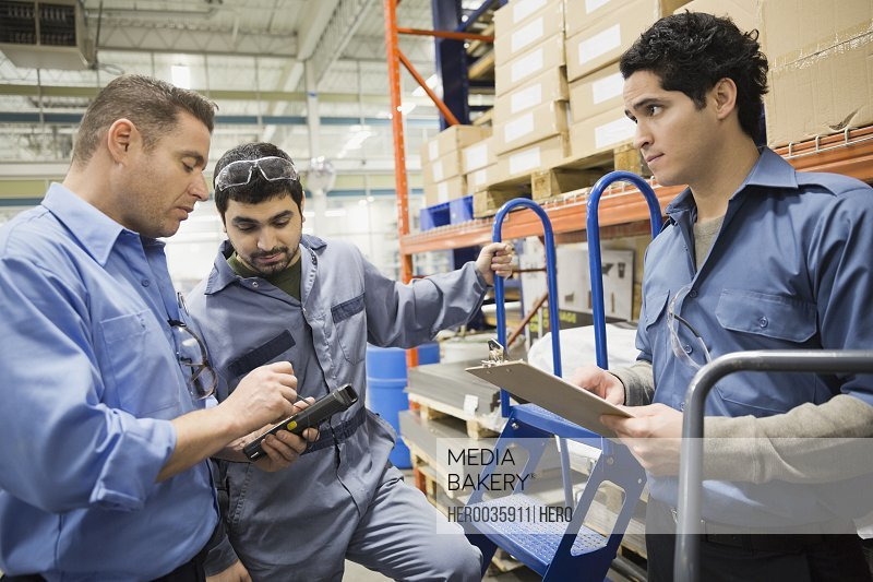 Male workers in warehouse