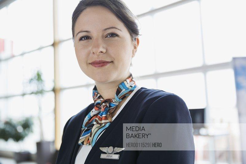 Portrait of confident flight attendant in airport