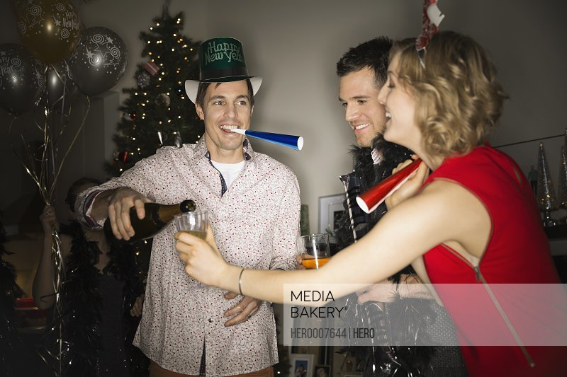 Friends enjoying New Years Eve party at home