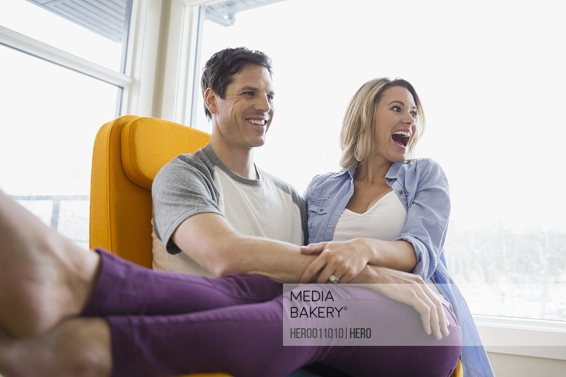 Enthusiastic couple in living room