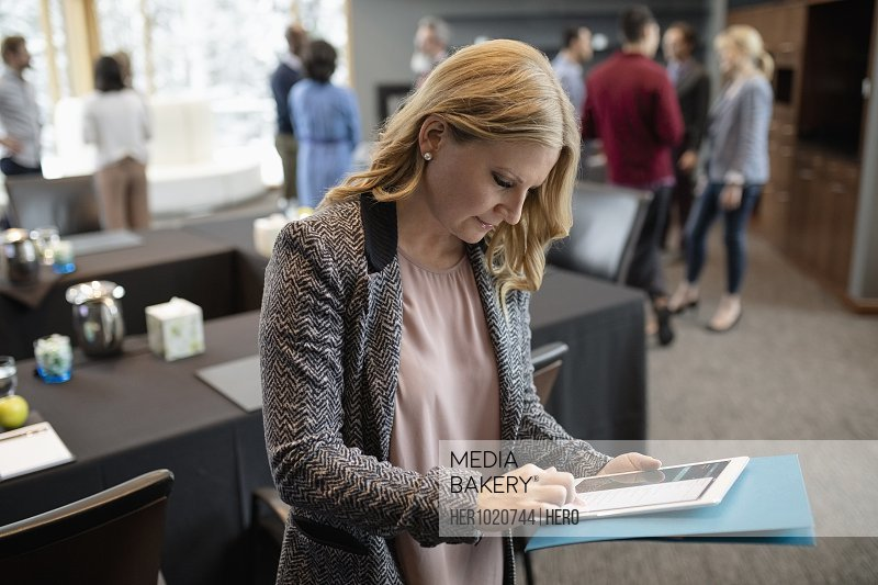 Businesswoman using digital tablet at conference