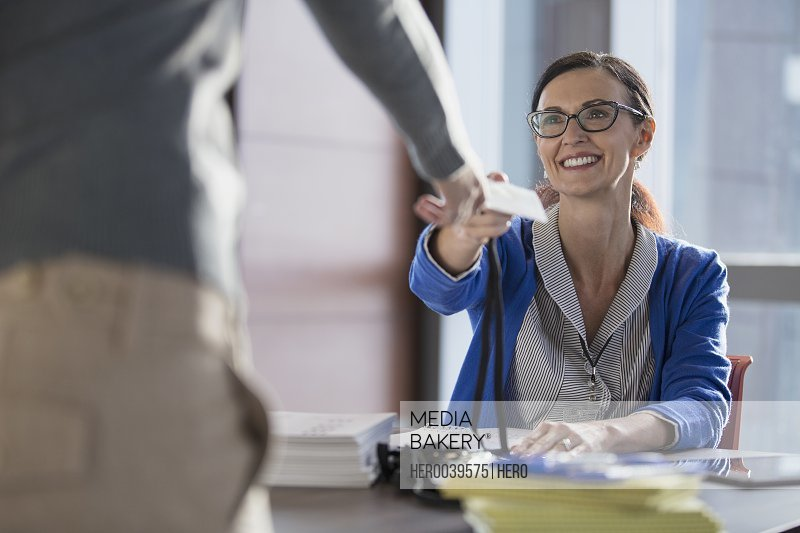 Woman picking up conference badge