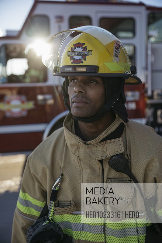 Portrait confident, tough male firefighter looking away