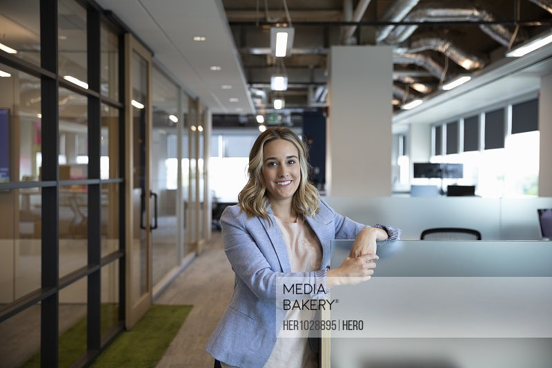 Portrait of young cheerful businesswoman in office