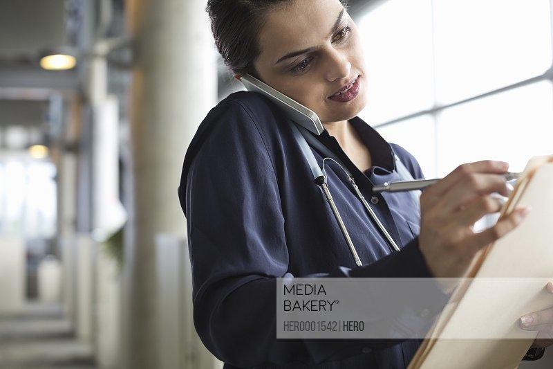 Female doctor multitasking