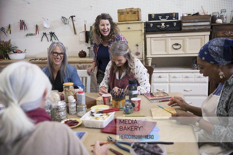 Women enjoying mosaic art and craft class