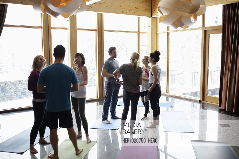 People talking after yoga class in studio