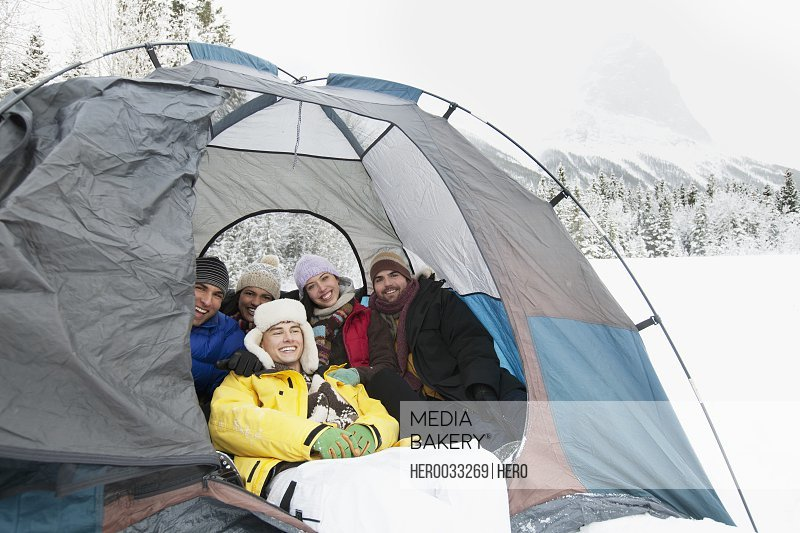 young adults enjoying winter camping