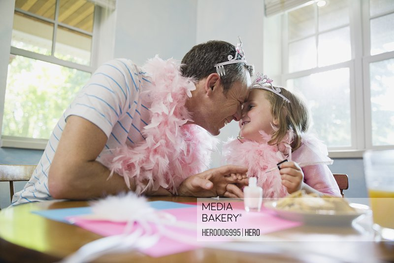 Little girl and father giving nose kisses