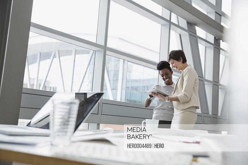 Businesswomen using digital tablet in office building