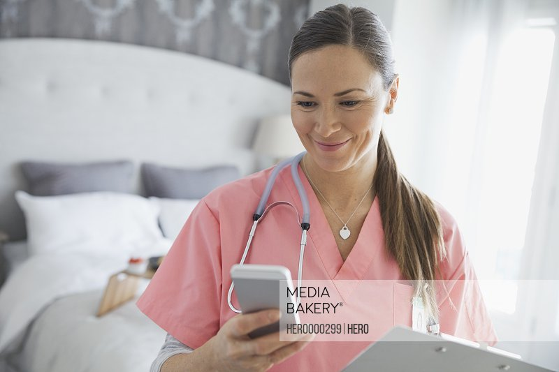 Home nurse reading text message