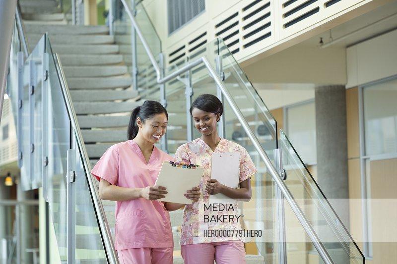 Nurses discussing information