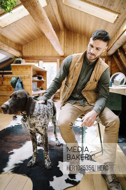 Man with dog in cabin