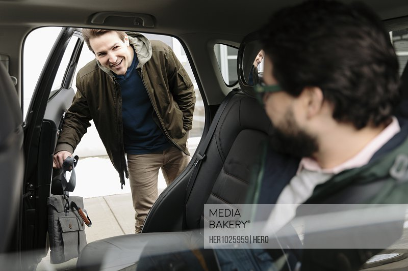 Male passengers sharing crowdsourced taxi