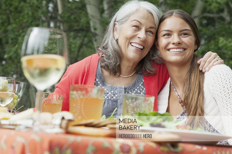 grandmother and grandaughter together at outdoor meal