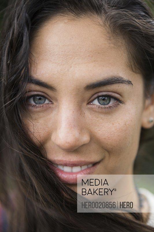Close up full frame portrait smiling brunette woman