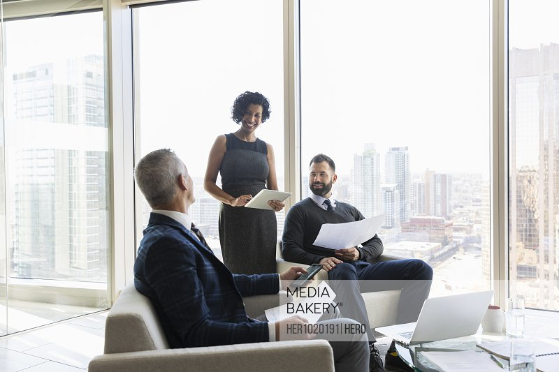 Business people discussing paperwork in urban office