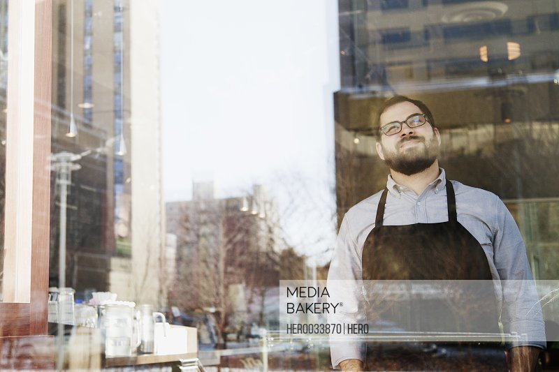 coffee shop owner looking out window