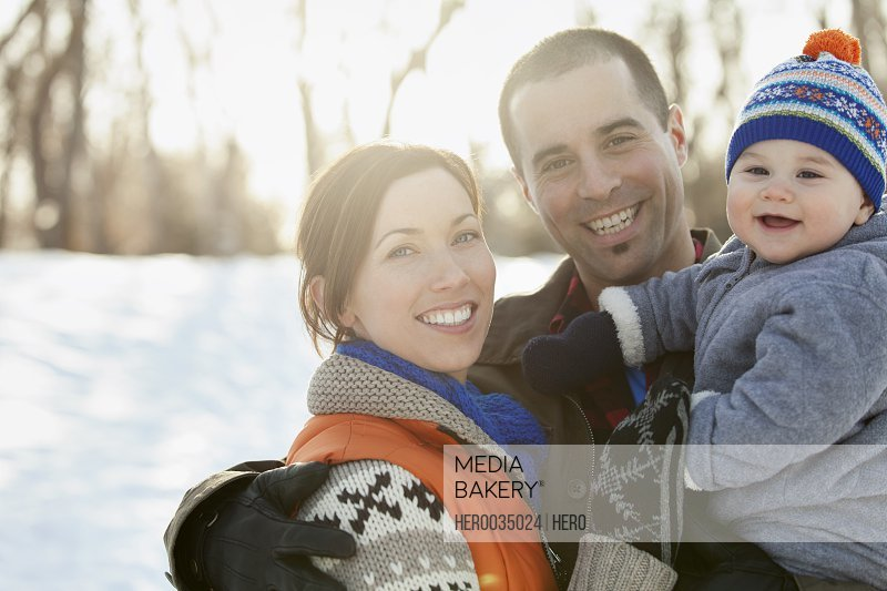 Portrait of family outdoors in winter