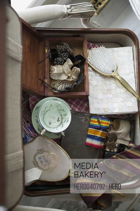 Overhead view of old memorabilia in suitcase