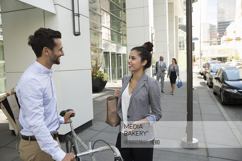 Business people talking on urban sidewalk