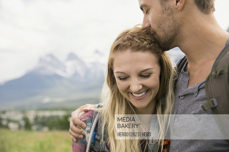 Affectionate couple near mountains